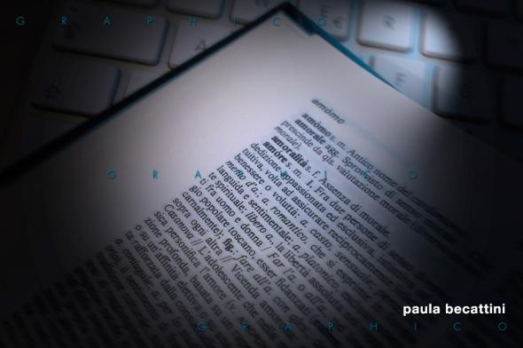 """Vocabolario aperto su tastiera alla parola """"Amore"""""""